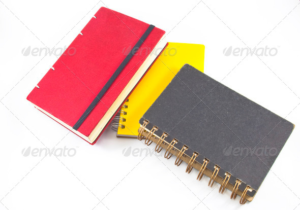 black,red and yellow notebooks closed isolated over white. Book - Stock Photo - Images
