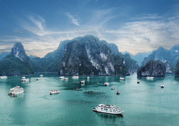 Early morning landscape with blue fog at Ha Long Bay, South China Sea, Vietnam - Stock Photo - Images