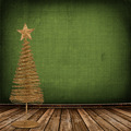 Christmas golden spruce in the old room, decorated with wallpape - PhotoDune Item for Sale