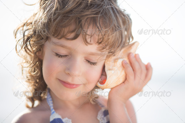 Child at the beach - Stock Photo - Images