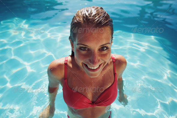 Female in bikini smiling at camera looking funny - Stock Photo - Images