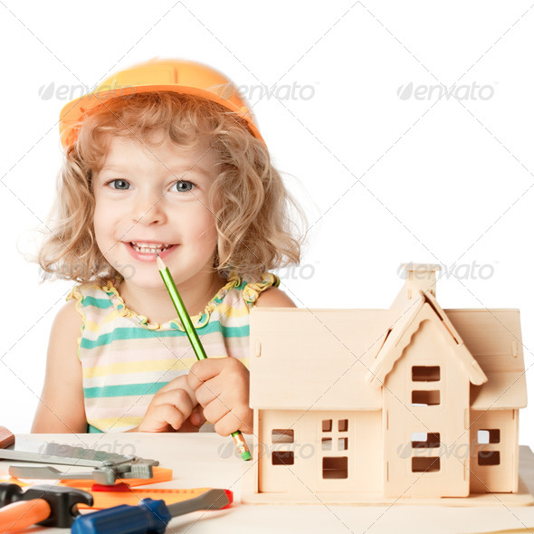 Happy child builds house - Stock Photo - Images