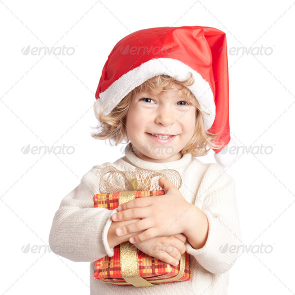 Happy child with Christmas gift - Stock Photo - Images