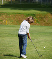 Young golfer performs a golf shot from the fairway. - PhotoDune Item for Sale