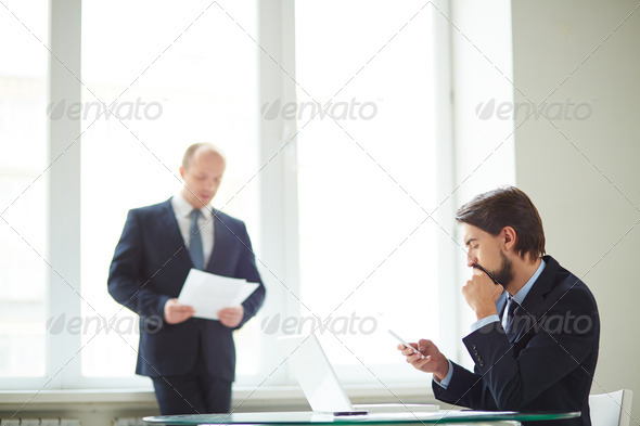 Businessmen in office - Stock Photo - Images