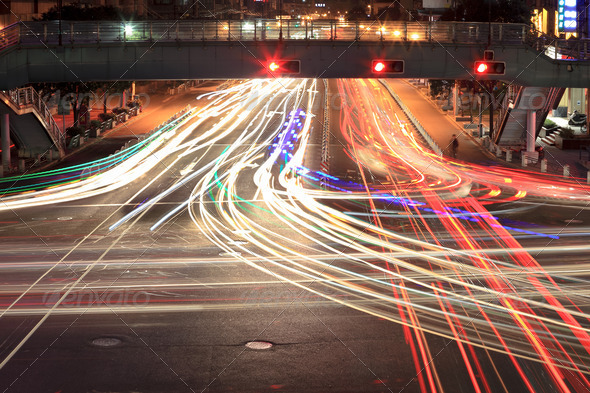 light traces on crossroad at night - Stock Photo - Images