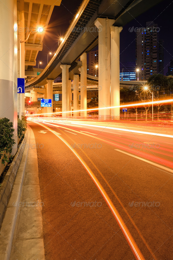 city traffic under the viaduct at night - Stock Photo - Images