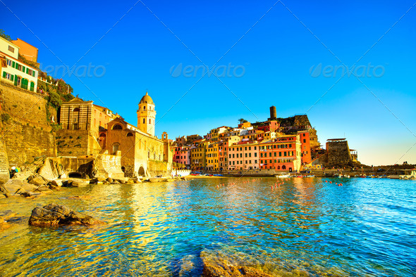 Vernazza village, church, rocks and sea harbor on sunset. Cinque - Stock Photo - Images