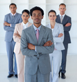 Afro-American businessman in front of his team - PhotoDune Item for Sale