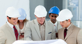 A group of architect discussing a construction plan - PhotoDune Item for Sale