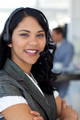 Confident ethnic businesswoman in a call center - PhotoDune Item for Sale