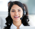 Beautiful businesswoman wearing a headset to talk with customer - PhotoDune Item for Sale