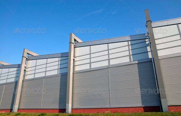 Modern facade of an industrial building - Stock Photo - Images