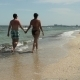Couple Walking The Beach - VideoHive Item for Sale