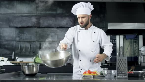 Chef Cooking Food At Kitchen Restaurant Concentrated Chef Tossing Food By Stockbusters