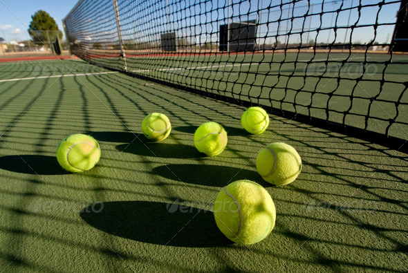 Tennis balls and court - Stock Photo - Images