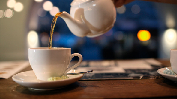 Pouring Black Hot Tea Into The Cup by Grey_Coast_Media | VideoHive