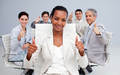 Afro-American businesswoman and her team with thumbs up - PhotoDune Item for Sale
