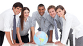 Portrait of business team around a terrestrial globe - PhotoDune Item for Sale