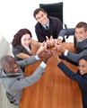 Happy business people with thumbs up in a meeting