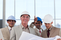 A group of architects discussing a construction plan - PhotoDune Item for Sale