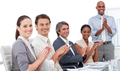 Assertive business people clapping a good presentation - PhotoDune Item for Sale