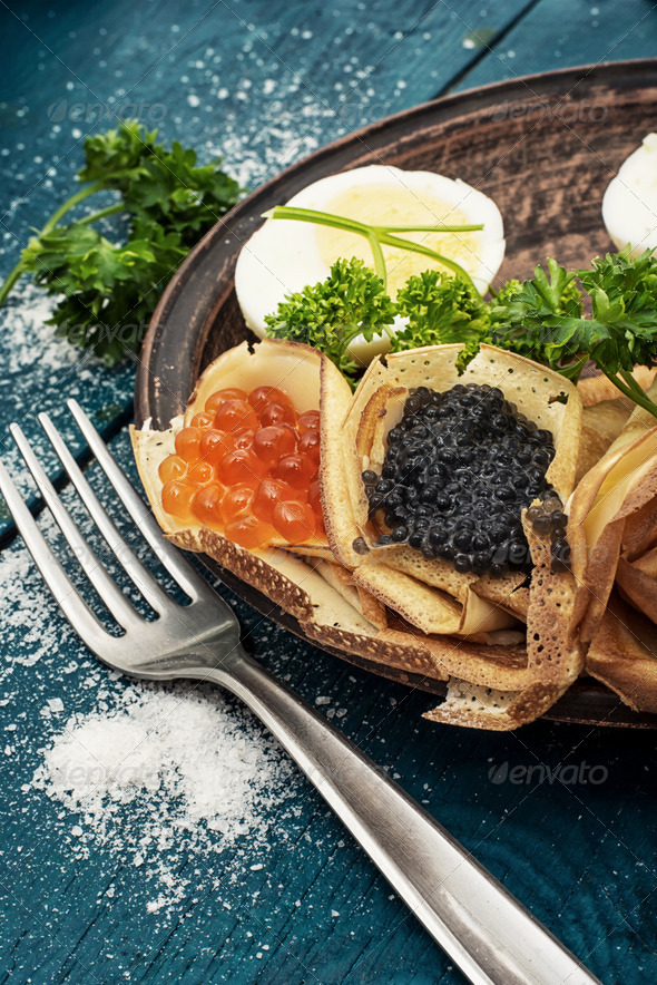 delicious pancakes stuffed with red and black caviar - Stock Photo - Images