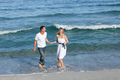 Romantic couple walking at the seaside