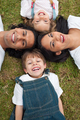Little boy lying in a circle with his family in a park - PhotoDune Item for Sale