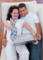 Couple buying online at home with thums up - PhotoDune Item for Sale