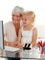 Granddaughter and grandmother using a computer