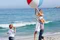 Happy mother and her children playing with a ball - PhotoDune Item for Sale