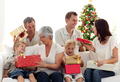 Happy family at home opening Christmas presents - PhotoDune Item for Sale