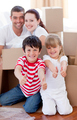 Family moving house with boxes and thumbs up - PhotoDune Item for Sale