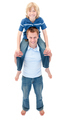 Portrait of father giving his son piggyback ride