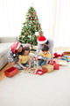 Family decorating a Christmas tree - PhotoDune Item for Sale