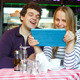 Young Couple In Cafe Having A Video Chat On Tablet - VideoHive Item for Sale