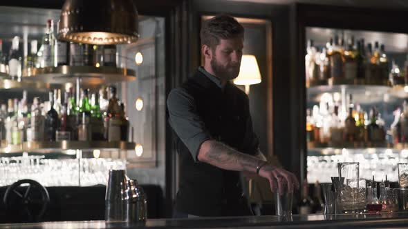 Handsome Bartender Professionally Juggling Shaker and Doing a Show in Beautiful Modern Bar