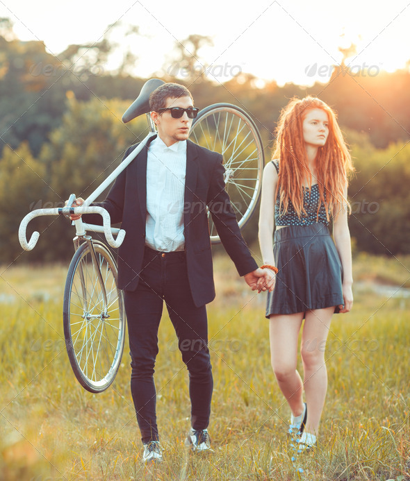 Guy with the girl and bicycle outdoors - Stock Photo - Images