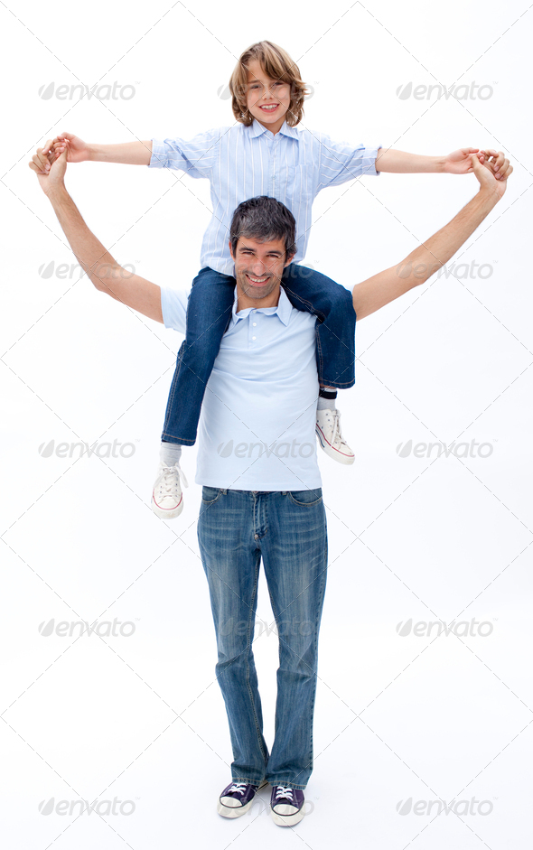Dad and son playing together - Stock Photo - Images