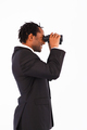 Businessman searching for something with binoculars against a white background