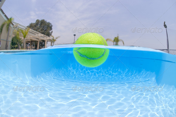 Tennis ball in pool - Stock Photo - Images