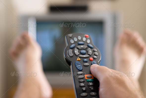 Man watching television - Stock Photo - Images