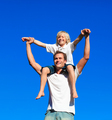 Child sitting on his father's shoulders
