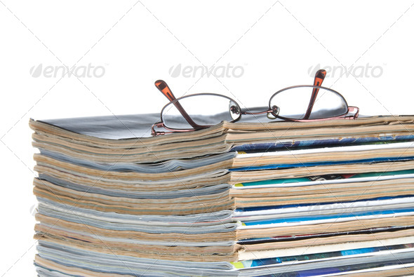 Stack of old magazines & reading glasses - Stock Photo - Images