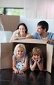 Happy family playing at home with boxes