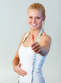 Beautiful woman with thumb up after weight loss focus on woman - PhotoDune Item for Sale