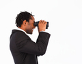 Searching for something with binoculars against a white background