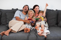 Joyful family playing video games at home