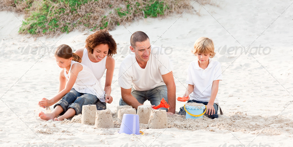 Family playing with the sand - Stock Photo - Images